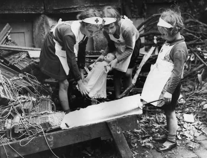 Young Daughters Of Air Raid Wardens In South-east London Practising First Aid With The Aid Of Their Dolls, 1940