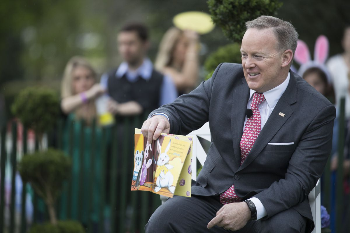 Mandatory Credit: Photo by SHAWN THEW/EPA/REX/Shutterstock (8612849g) Sean Spicer US President Donald J. Trump holds the annual White House Easter Egg Roll, Washington, USA - 17 Apr 2017 White House Press Secretary Sean Spicer reads to children during the White House Easter Egg Roll on the South Lawn of the White House in Washington, DC, USA, 17 April 2017. President Trump and First Lady Melania Trump are hosting thousands of people during the annual celebration of Easter.