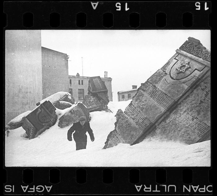 1940: A Man Walking In Winter In The Ruins Of The Synagogue On Wolborska Street (Destroyed By Germans In 1939)