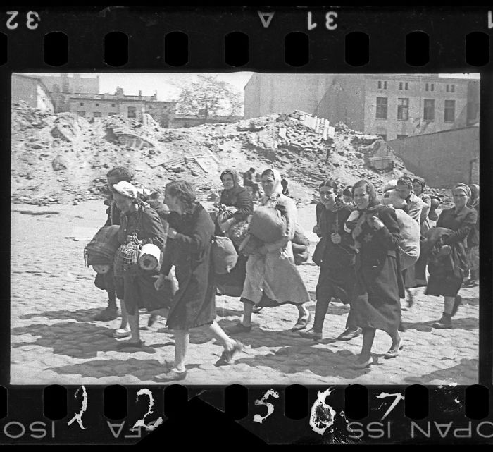 1940-1944: A Group Of Women With Sacks And Pails, Walking Past Synagogue Ruins Heading For Deportation